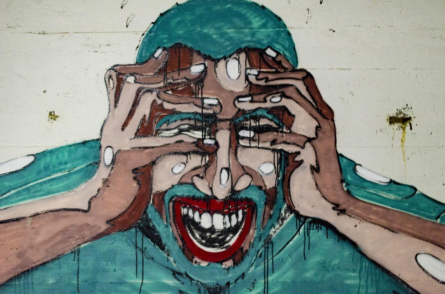peinture moderne représentant un homme se tenant la tête